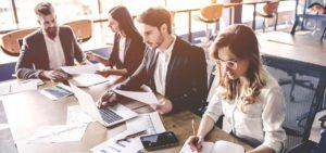 Header-Employees-at-Desk
