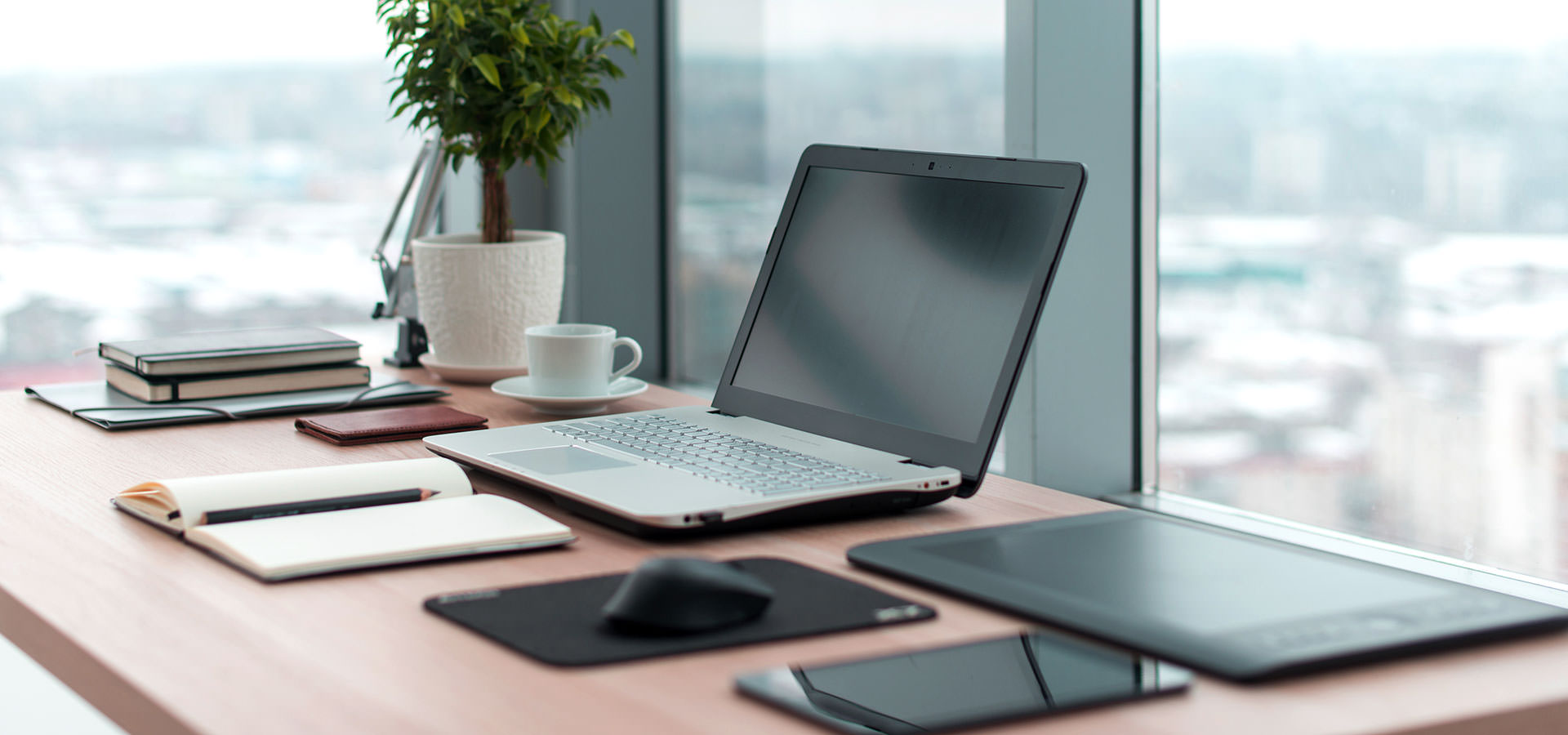 Header Laptop On Desk Highpoint Insurance Group