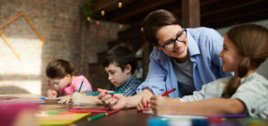Child-Care-Center-Insurance-Header-Children-with-Teacher-at-the-Child-Care-Center