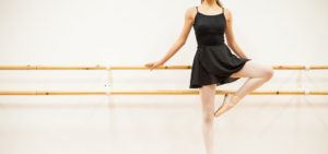 Dance-Studio-Insurance-Header-Young-Female-Ballet-Dance-Standing-at-the-Barre