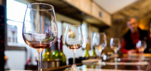 Winery-Insurance-Header-Group-of-Wine-Glasses-Being-Displayed-for-a-Tasting